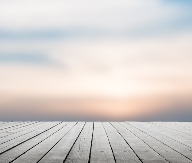Wooden table with blurred sky natural background with bokeh