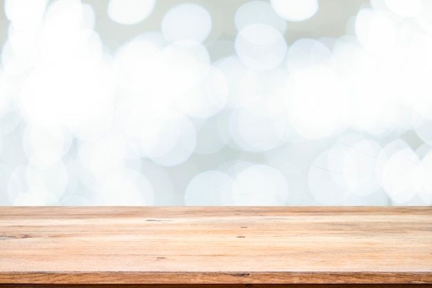 Wooden table with bokeh abstract background.