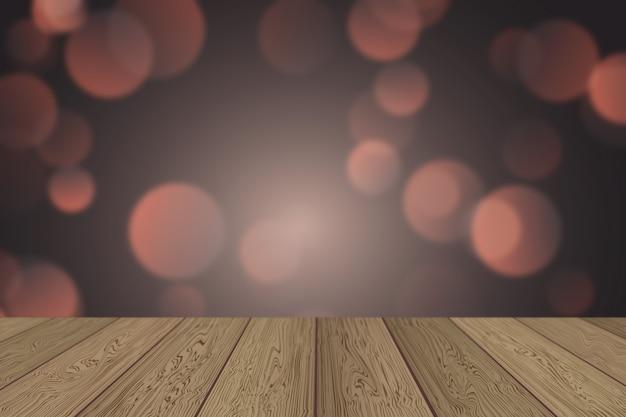 クリスマスの背景のボケライトと木製のテーブル
