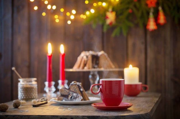 Wooden table with christmas cake and decor