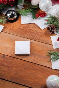 The wooden table with christmas decorations with copy space for text. christmas mockup concept