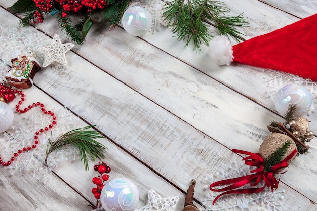 Wooden table with christmas decorations with copy space for text.