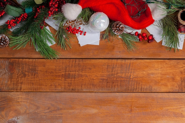 Wooden table with christmas decorations with copy space for text