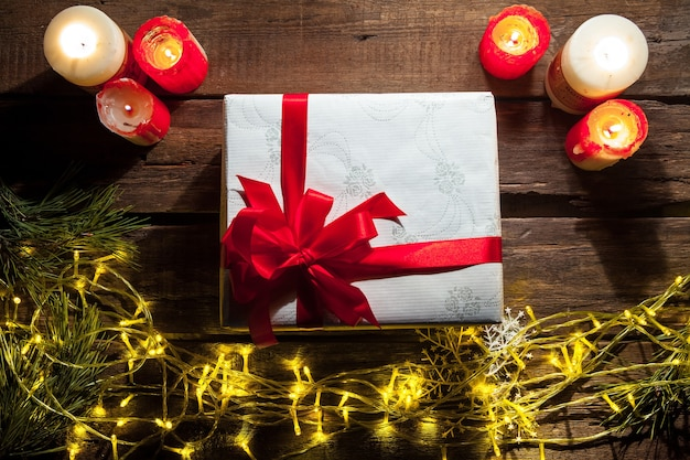 The wooden table with christmas decorations with gift. christmas mockup concept
