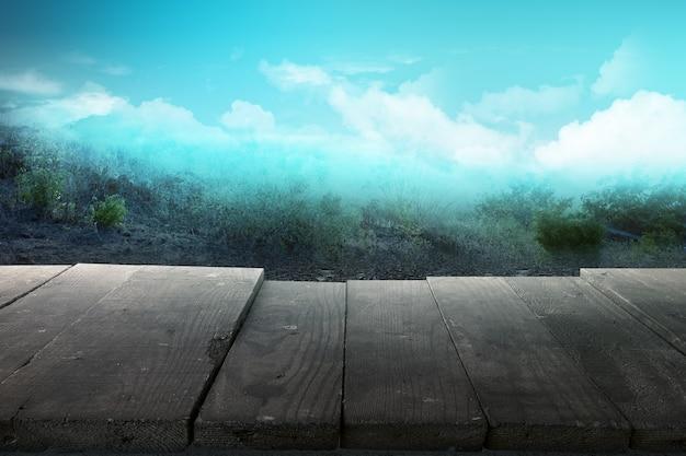 劇的な空の背景を持つ木製のテーブル Premium写真