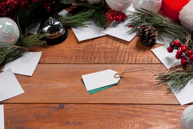 The wooden table with a empty  blank price tag and christmas decorations.