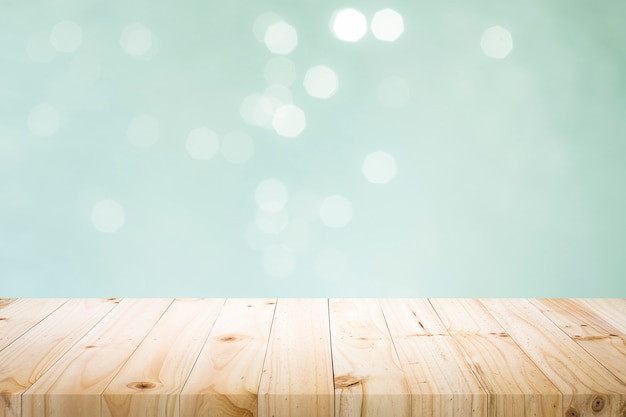 Wooden table with mint  bokeh abstract background.
