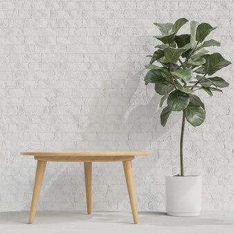흰색 벽돌 벽에 식물을 가진 나무 테이블