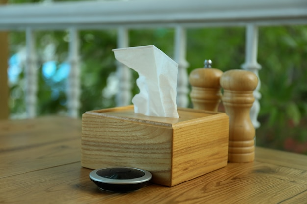 Wooden table with restaurant accessories, close up