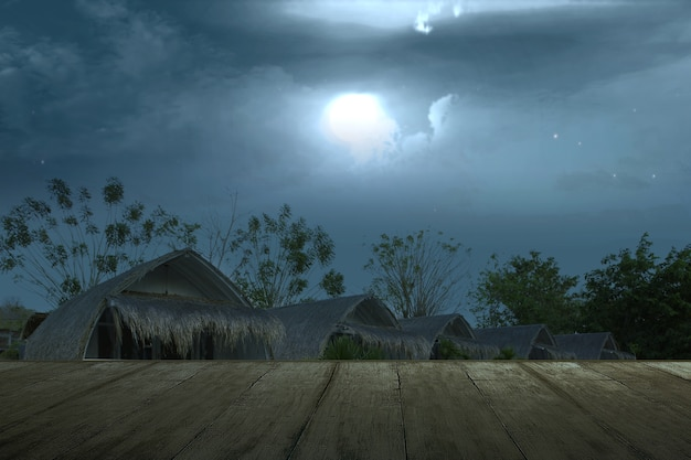 Wooden table with spooky resort view with moonlight and night scene