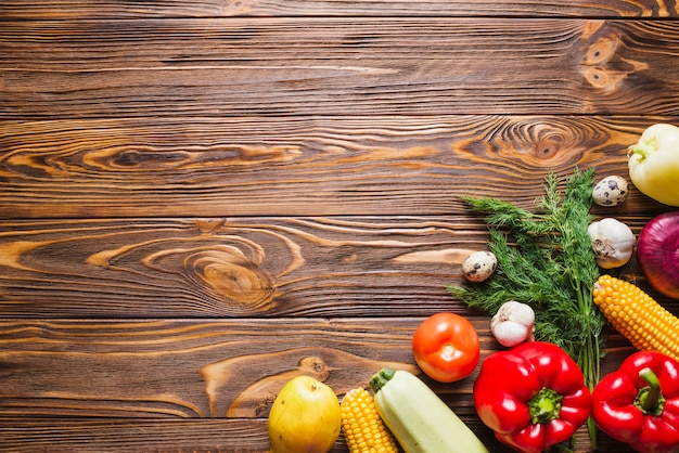 Wooden table with vegetables on right