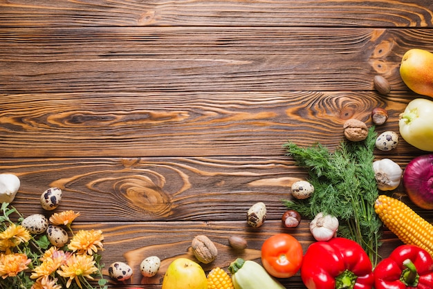 Wooden table with vegetables on sides