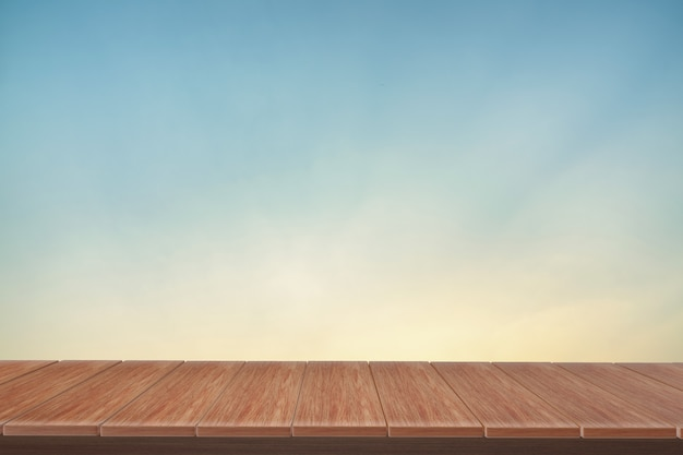 Wooden table with view  blue backdrop.you can used for display products.