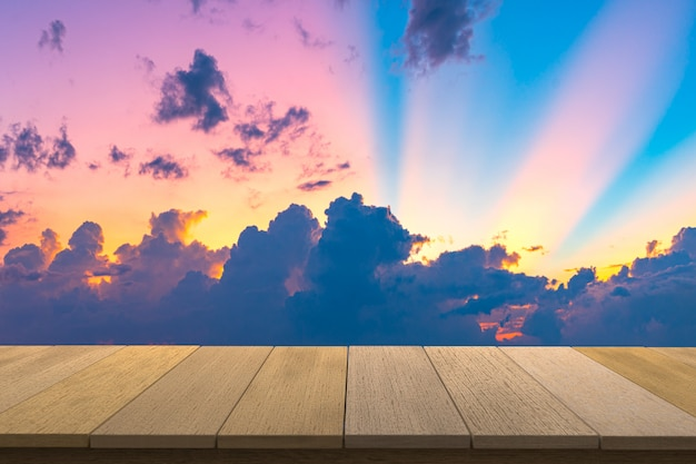 Wooden table with view sunset sky  backdrop.you can used for display products.  copyspace.