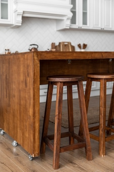 Wooden table with wheels in kitchen
