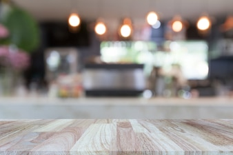 Wooden tabletop on blurred restaurant or coffee shop background