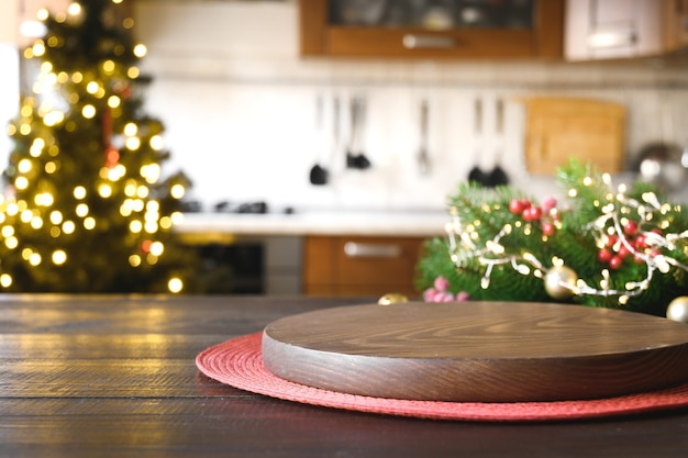 Wooden tabletop with christmas decoration in kitchen