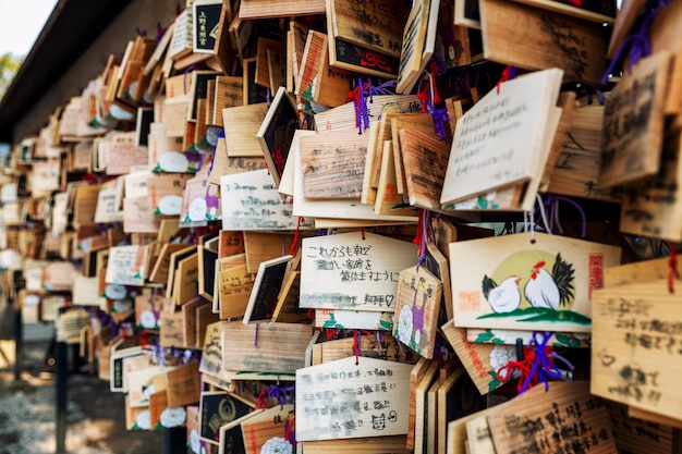 Wooden tablets with wishes written on them in japanese temple