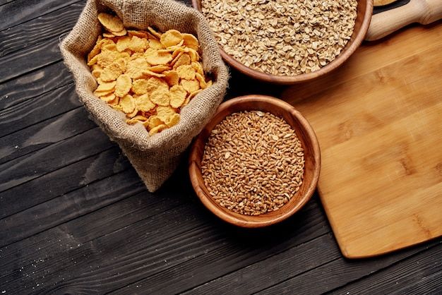 Wooden tableware cereals products view from above