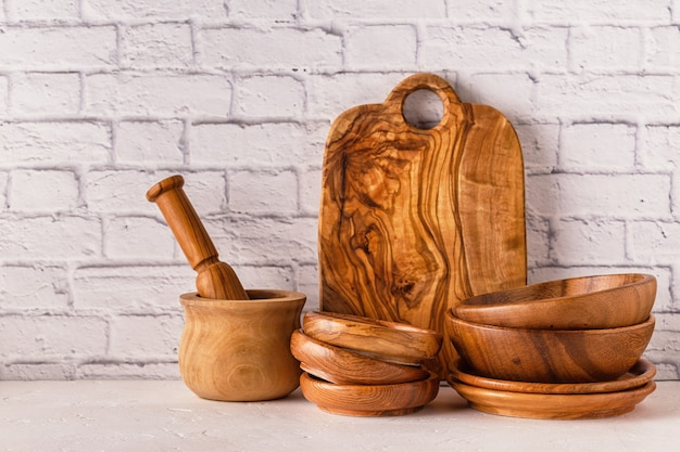 Wooden tableware on a white table