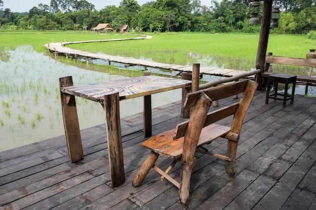 Wooden terrace near paddy rice field