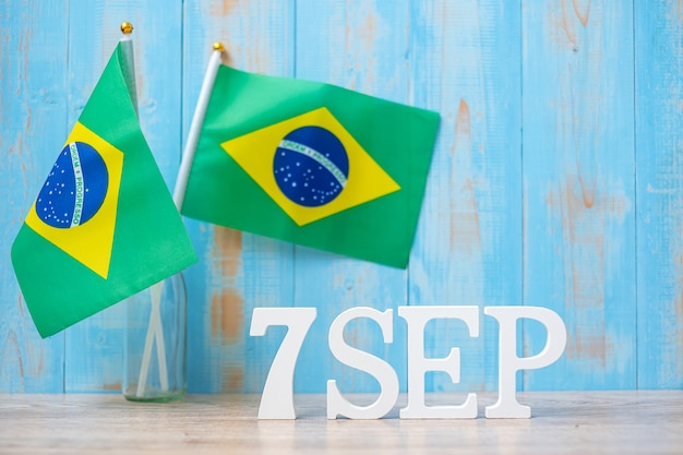 Wooden text of september 7th with miniature brazil flags. independence day of brazil and happy celebration concepts
