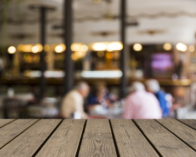 Wooden texture looking out to blurred bar