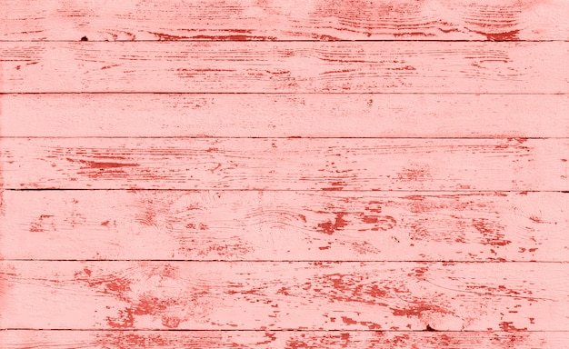 Wooden texture toned to living coral color