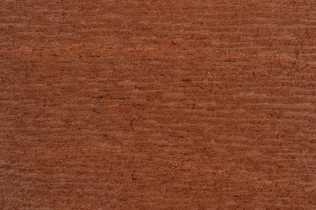 Wooden texture use as natural background for design. dark brown scratched wooden cutting board