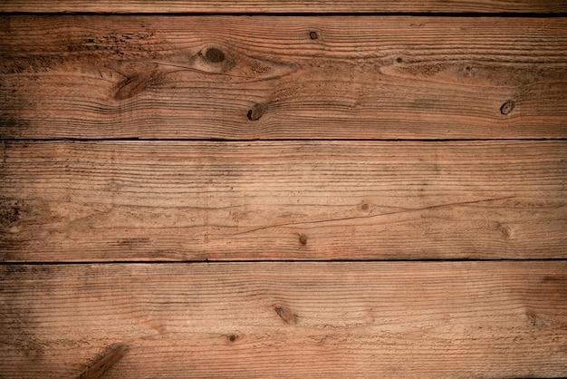 木製のテクスチャの壁。茶色の木目テクスチャ、背景製品のテキストや作業デザインを追加するための古い木目テクスチャ。トップビュー-木製食品テーブル