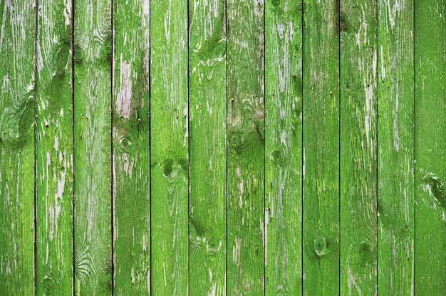 Wooden textured background of bright green boards