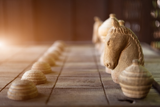 Wooden thai chess on wooden board. strategy and hobby concept. business and leisure theme
