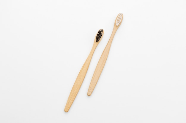 Wooden toothbrushes for the care of teeth on white