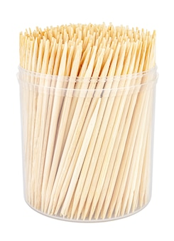Wooden toothpicks close-up in transparent plastic cylindric box without cap isolated on white background