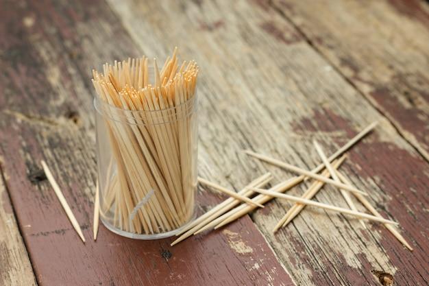Wooden toothpicks on wood table