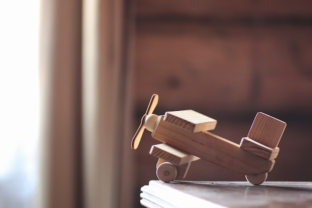Wooden toy airplane on the table