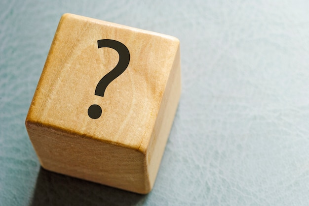 Wooden toy block with printed question mark