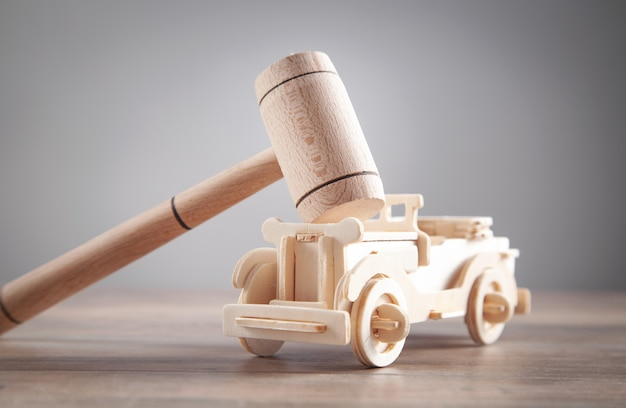 Wooden toy car and judge gavel.