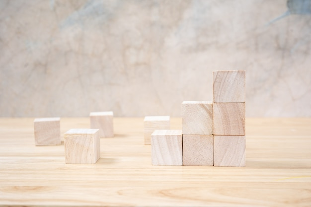 Wooden toy cubes on a wooden table