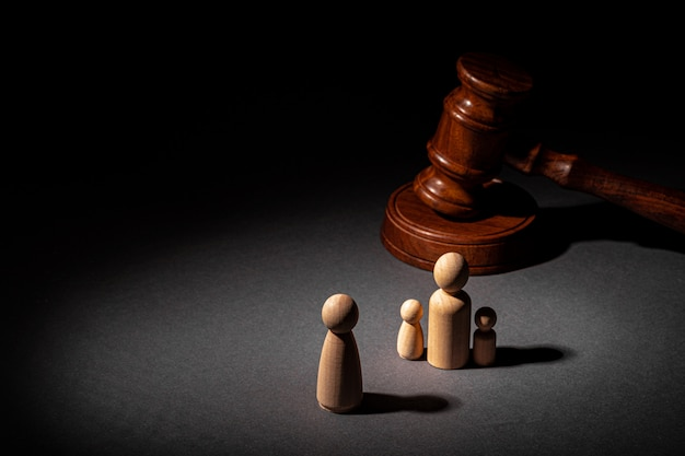 Wooden toy family and judge mallet. family divorce concept