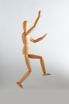 Wooden toy playing basketball