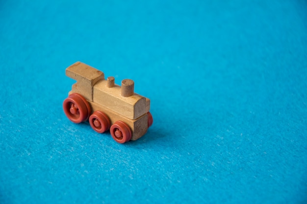 Wooden toy train on blue