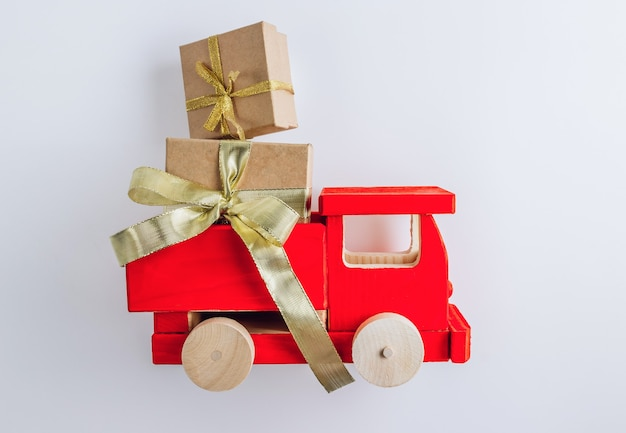 Wooden toy truck with christmas gifts