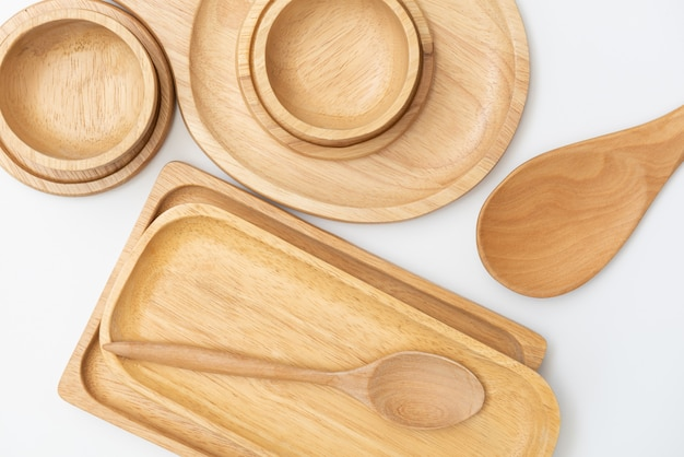 Wooden tray,bowl and spoon dishware isolated on white background