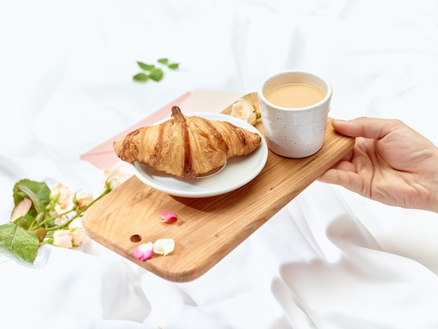 Wooden tray with breakfast