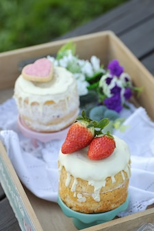 Wooden tray with strawberry cake