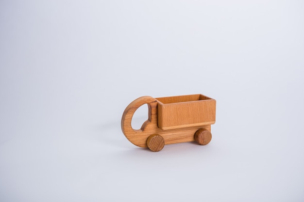 Wooden truck car on a white space with copy space.