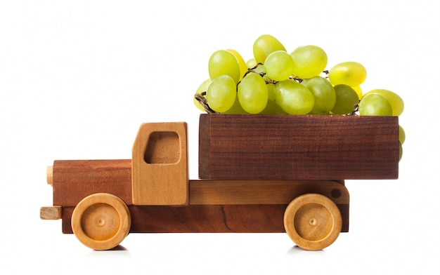 Wooden truck carries white grapes
