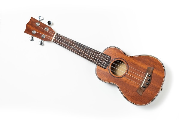 Wooden ukulele on white