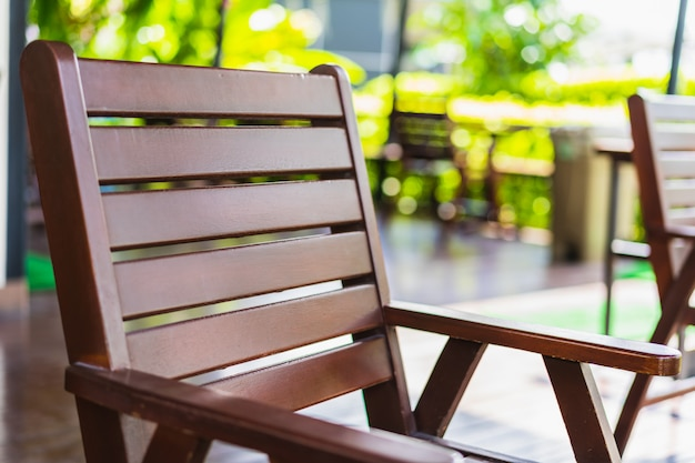 Wooden vintage chair in the garden with blurred background